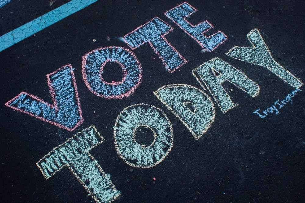 """A message written with chalk in the parking lot outside North Side Church of God in Muncie reads """"Vote Today."""" Primary elections for mayor and other positions were held May 7, 2019. Blake Chapman, DN"""