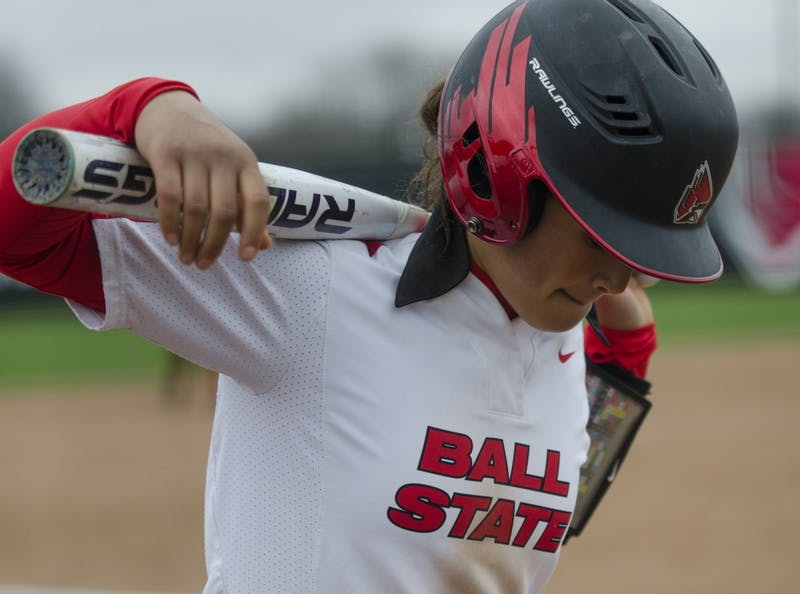 Junior second baseman Maddy Labrador waits in the on-deck circle during the second game of the double-header against Northern Illinois on April 4 at the Softball Field at the First Merchants Ballpark Complex. Ball State won the first game 3-2 and the second game 6-4. Emma Rogers // DN