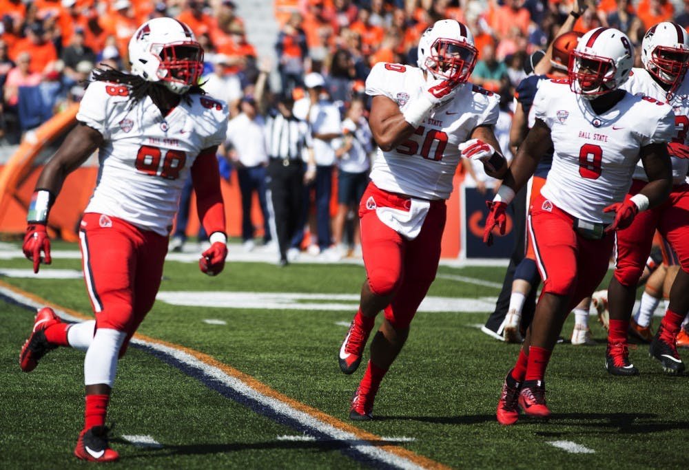 <p>Ball State defensive end Anthony Winbush leads the defense off the field after a sack against the University of Illinois on Sept. 2, 2017. Winbush finished the game with seven total tackles, four of which were for a loss, and three sacks. <strong>Robby General, DN</strong></p>
