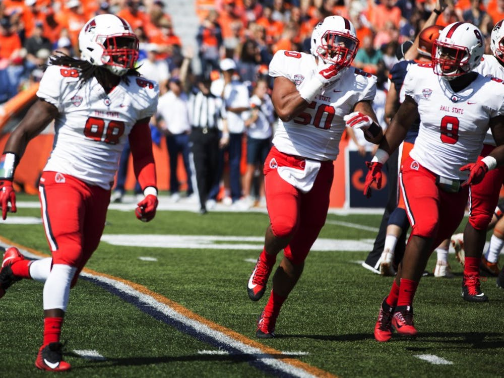Ball State defensive end Anthony Winbush leads the defense off the field after a sack against the University of Illinois on Sept. 2, 2017. Winbush finished the game with seven total tackles, four of which were for a loss, and three sacks. Robby General, DN