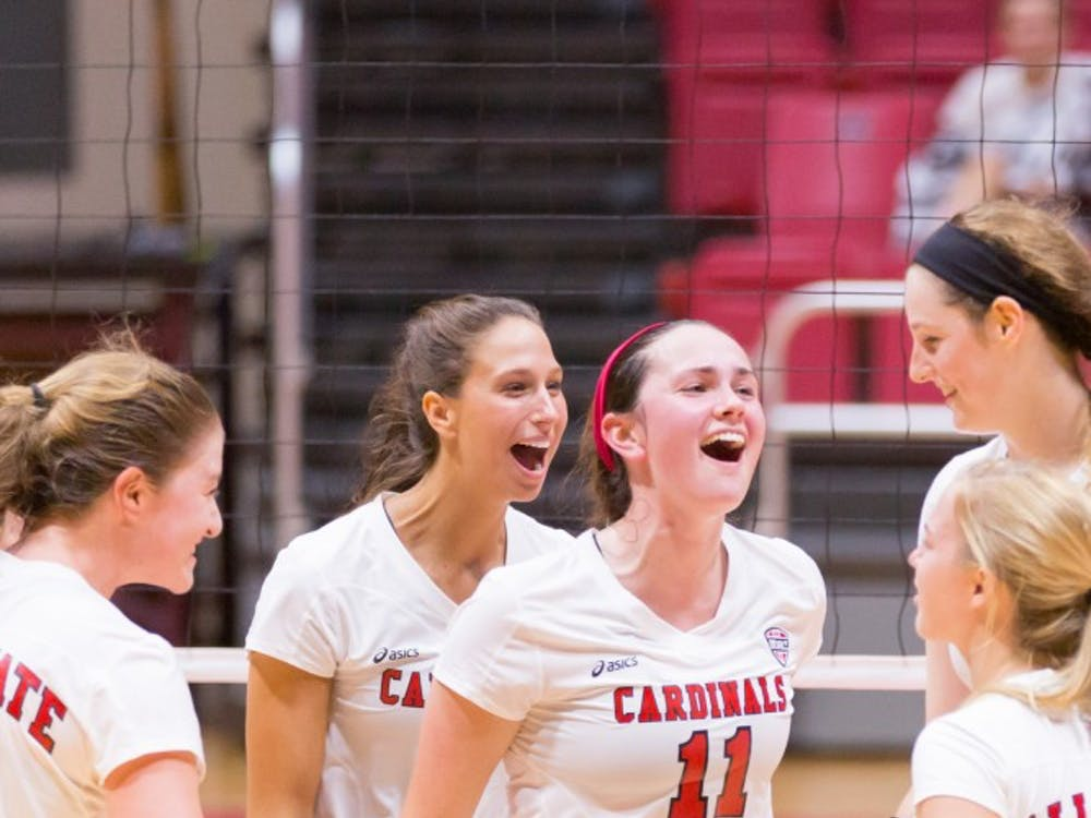 Freshman setter Amber Seaman celebrates after a score with her fellow teammates at the game against IUPUI on Aug. 31, 2016 at John E. Worthen Arena. Friday's match against Indiana starts at 7 p.m.  Kyle Crawford // DN File