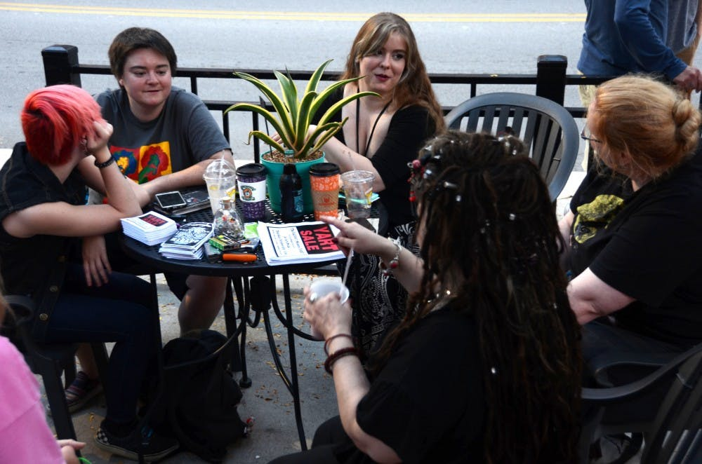<p>(From left) Brooklyn Lambert, Brittaney Edwards, Ricbecka Deardorff, Moth Danner, and Lucian Cruor share their stories over coffee at the weekly Stitch 'n Bitch meeting at The Cup on Sept. 17. The group talks about their week and creates art every Sunday. Kaci Alvarez, DN</p>