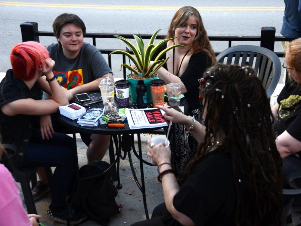 (From left) Brooklyn Lambert, Brittaney Edwards, Ricbecka Deardorff, Moth Danner, and Lucian Cruor share their stories over coffee at the weekly Stitch 'n Bitch meeting at The Cup on Sept. 17. The group talks about their week and creates art every Sunday. Kaci Alvarez, DN