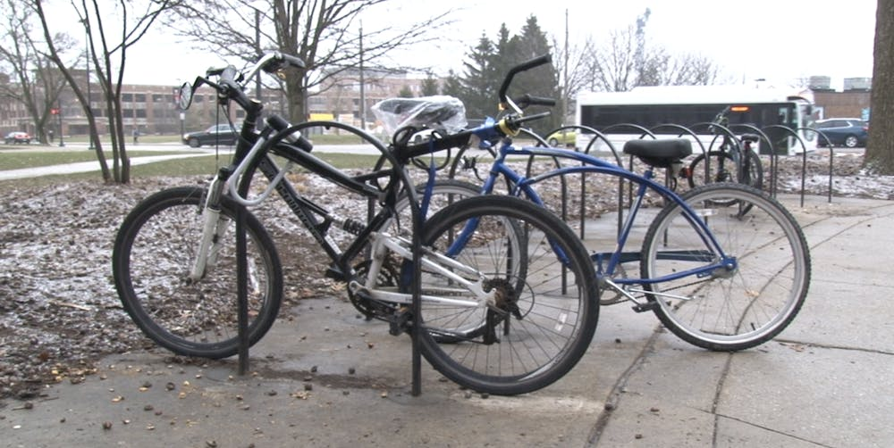 Some students continue to bike to classes despite the chilly temperatures.