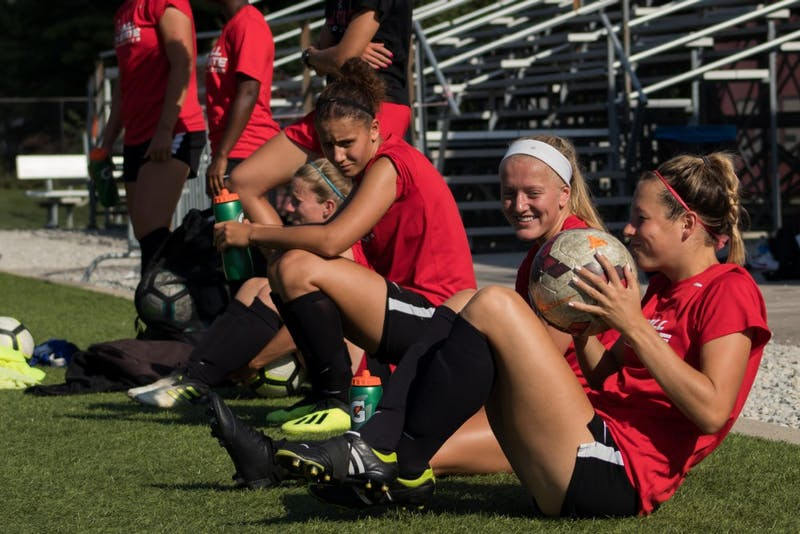 Members of the Ball State soccer team watch as their teammates scrimmage Wednesday Sept. 5, 2018 at Briner Sports Complex. Eric Pritchett, DN