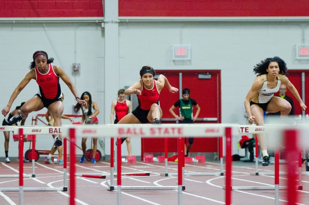 Ball State senior Anna-Kay West, left, and freshman Anasja Troutman, center, compete in the 60 meter hurdles on Feb. 16 in the Ball State Tune-up at the Field Sports building. Madeline Grosh, DN