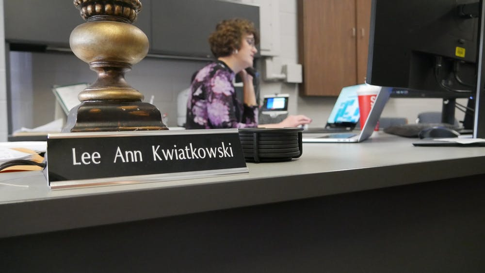<p>Lee Ann Kwiatkowski, Director of Public Education and CEO of Muncie Community Schools (MCS) sits at her desk Jan. 22, 2020, in the MCS Administration Office and Area Career Center. She has worked at the schools for almost 10 months and has previously worked in teaching, administrative and state-level positions. <strong>Jake Helmen, DN</strong></p>