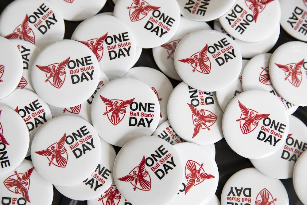 <p>One Ball State Day buttons sit on a table April 6, 2021, in the Letterman Building lobby. In addition to donations, there were challenges for donations during certain periods of time and for the amount raised in competition with other organizations. <strong>Jacob Musselman, DN</strong></p>