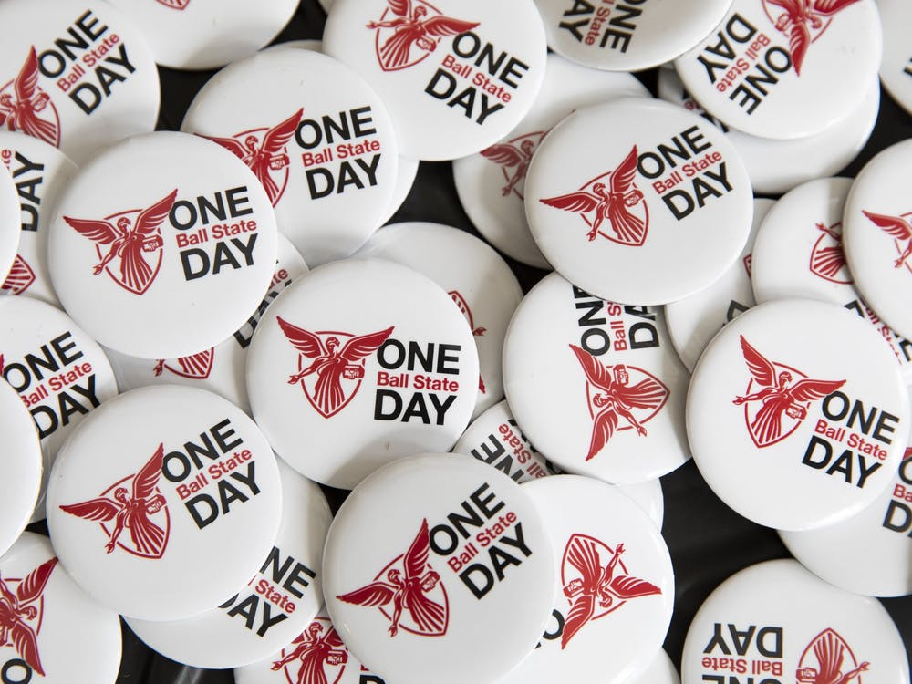 One Ball State Day buttons sit on a table April 6, 2021, in the Letterman Building lobby. In addition to donations, there were challenges for donations during certain periods of time and for the amount raised in competition with other organizations. Jacob Musselman, DN