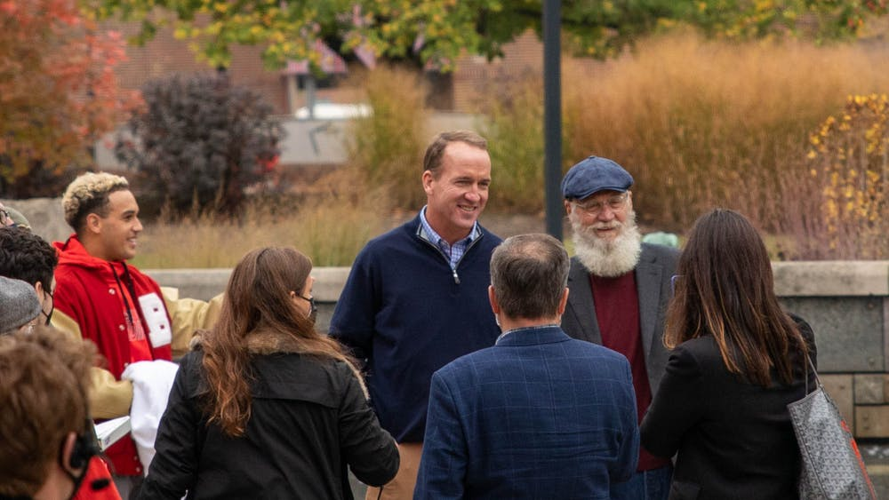 """Former Indianapolis Colts quarterback Peyton Manning and Ball State Alumnus David Letterman pose for a photo Oct. 20, 2020, at Ball State University. Ball State Alumnus David Letterman and former Indianapolis Colts quarterback Peyton Manning were seen filming on campus by Frog Baby and at Scheumann Stadium for an episode of """"Peyton's Places."""" Jaden Whiteman, DN"""