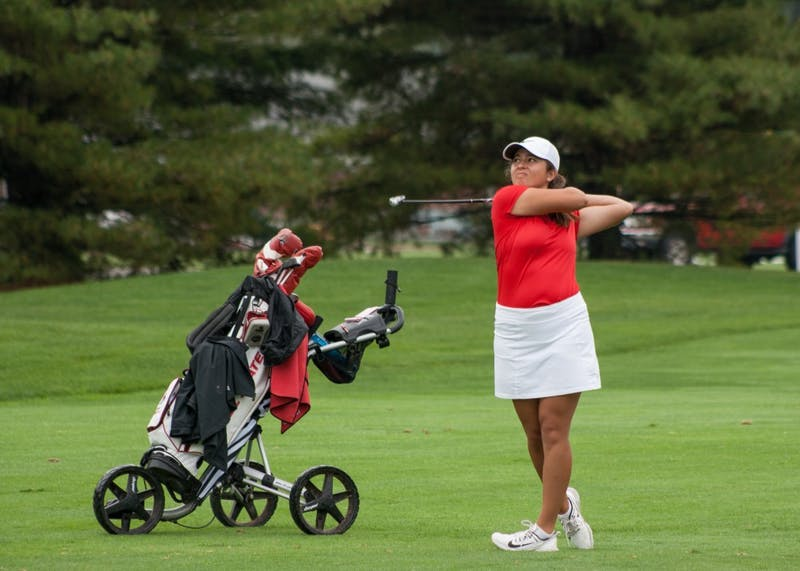 Sophomore Manon Tounalom tees off at hole 8 during the Cardinal Classic on Sept. 19. The tournament took place at the Player's Club in Yorktown. Kaiti Sullivan, DN File