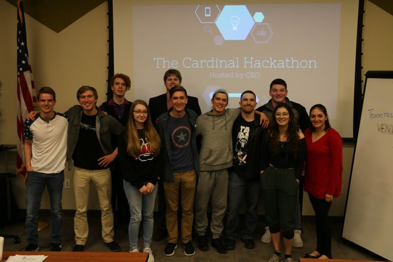 Participants at the first annual Cardinal Hackathon hosted by the Collegiate Entrepreneurs' Organization huddle for a photo March 2018. This year's second annual Hackathon will be held at the Innovation Connector and begin 6 p.m. Friday and end 6 p.m. Saturday. Brandi Lambertson, Photo Provided
