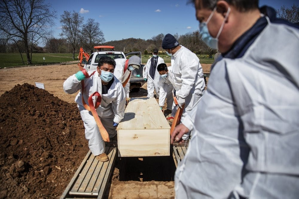 <p>In this April 6, 2020 photo, gravediggers lower the casket of someone who died of coronavirus at the Hebrew Free Burial Association&#x27;s cemetery in the Staten Island borough of New York. (AP Photo/David Goldman, File)<br/><br/></p>