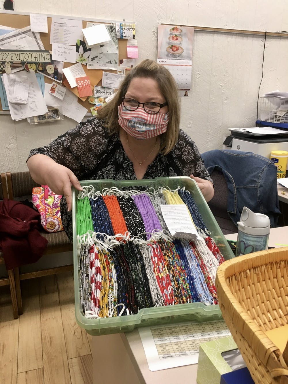 Shareen Wagley poses at The Mailroom with their new delivery of Susan's face masks. The Mailroom sells both Susan's and other local seamstresses adult- and child-sized masks. Moth Danner, Photo Provided
