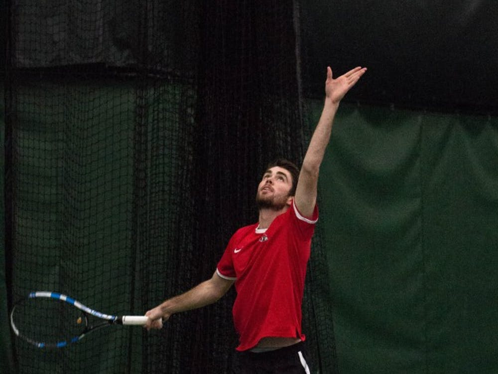 Sophomore Tom Carney prepares to serve the ball during his doubles match with teammate Matt Helm against Eastern Illinois' Jared Woodson and Freddie Ammer on Jan. 22 at Muncie's Northwest YMCA. The Cardinals won 6-1. Grace Ramey // DN