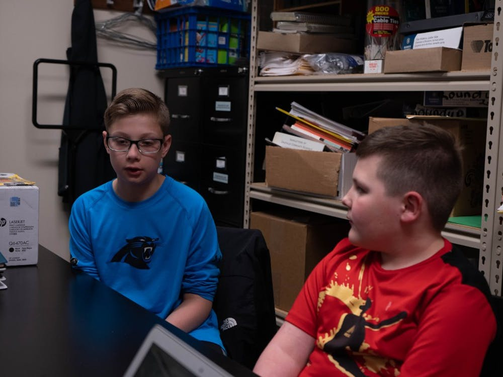 (Left to Right) Fifth grader Gavin Sharpe and second grader Brody Mccurdy talk at a table at Daleville Elementary School April 16, 2019. Sharpe is Mccurdy's big in the schools peer mentor program. Scott Fleener, DN