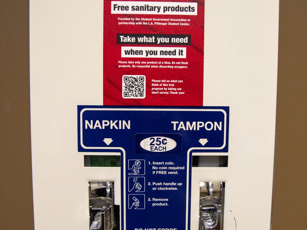 A menstrual product dispenser sits in one of the student center women's bathrooms March 22, 2021. Chief Administrator Gina Esposito has envisioned the free menstrual product program since Bold slate began campaigning. Jaden Whiteman, DN