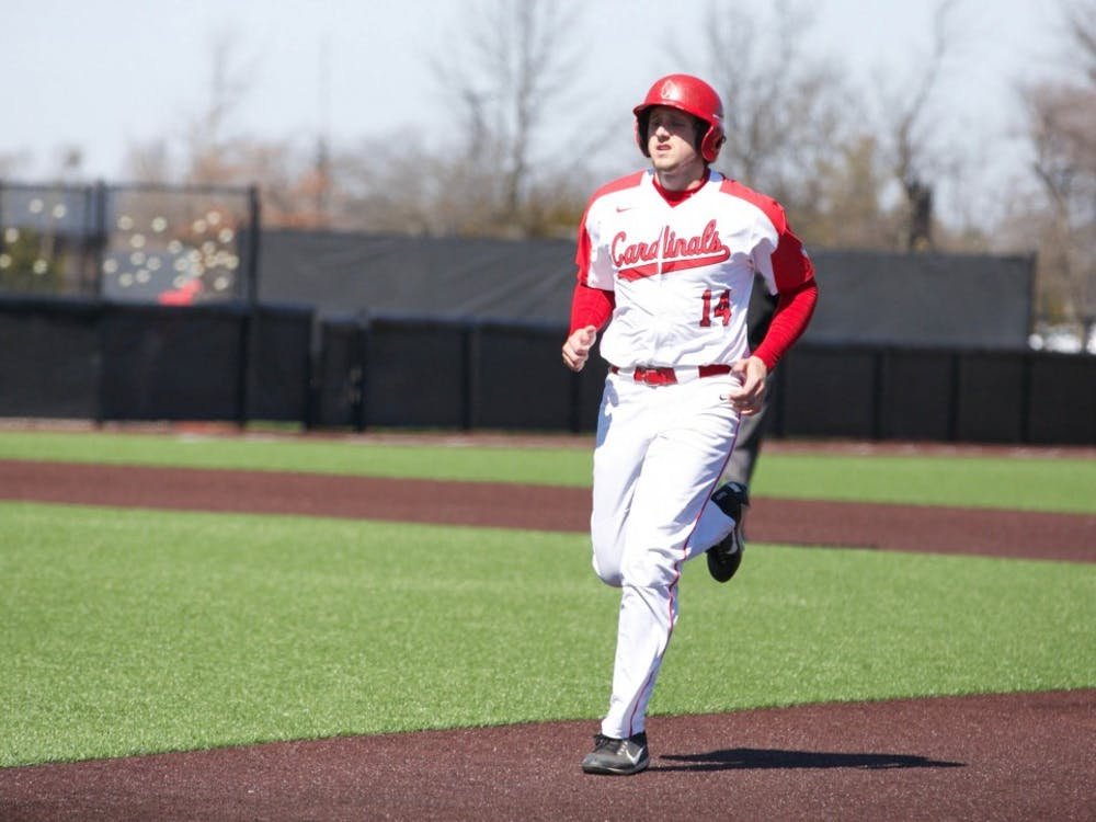 Freshman Rhett Wintner runs back to first base after one of his teammates strikes out during the fourth inning of the game against Dayton March 18. Carlee Ellison, DN