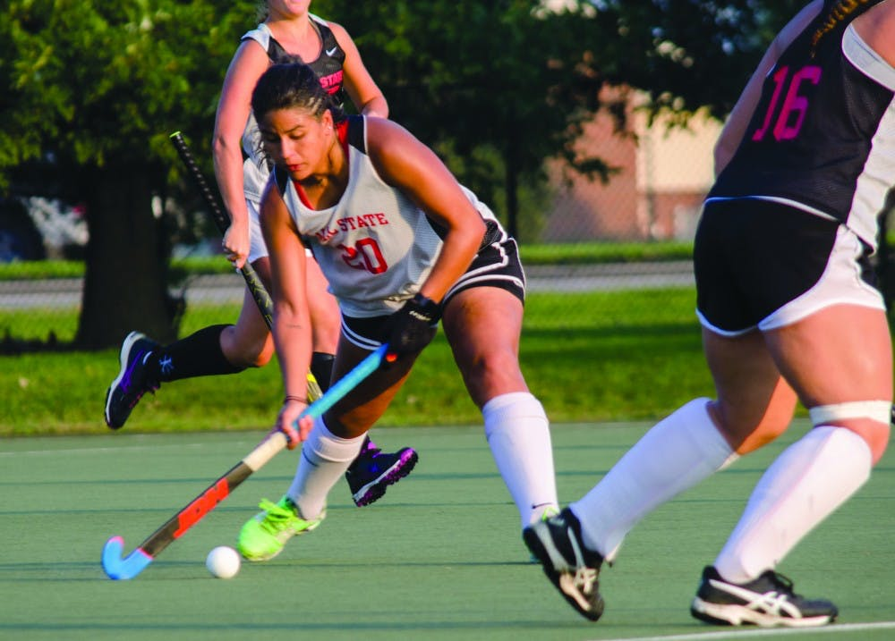 Junior Arantxa Rosainz Caloca, #20 swings the hockey stick towards the ball during practice  Sept. 17, 2018, at the Briner Sports Complex.  Stephanie Amador, DN