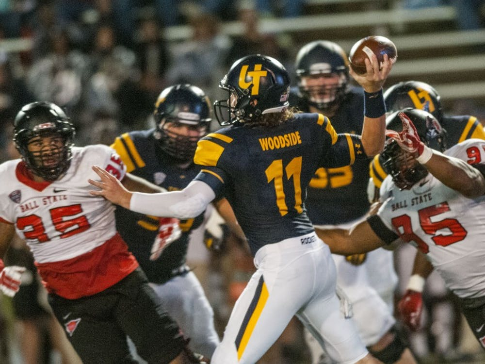 The Ball State defense pressures Toledo quarterback Logan Woodside during the game against Toledo at the Glass Bowl on Sept. 21. DN PHOTO JONATHAN MIKSANEK