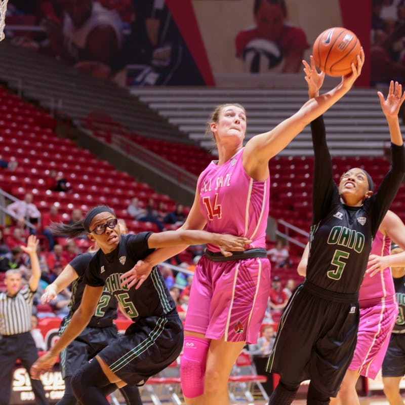 Senior center Renee Bennett reaches out for a rebound during the game against Ohio State on Feb. 11 in Worthen Arena. Crawford  // DN