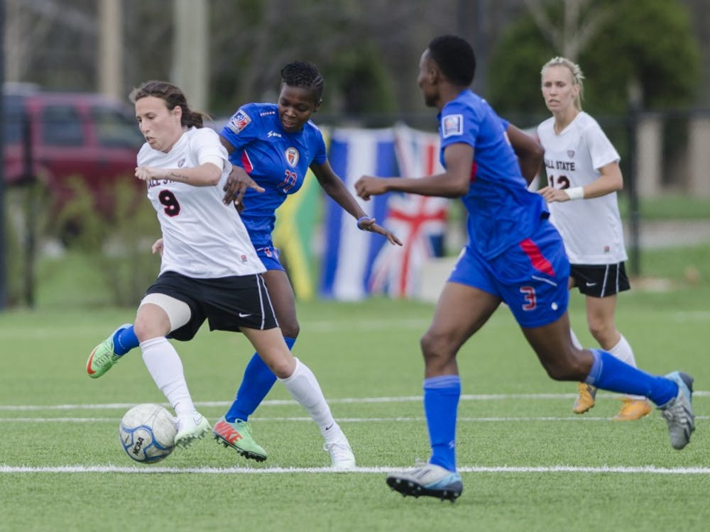 Redshirt junior Chelsy Swackhamer attempts to keep the ball away from members of the Haiti National team during the game on April 12 at the Briner Sports Complex. DN PHOTO BREANNA DAUGHERTY