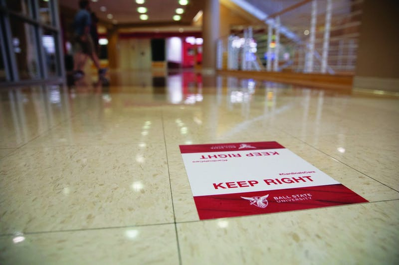 Signs directing people to walk on the right side of hallways were put up around Ball State University to keep people on one side of the path they are walking on. Jacob Musselman, DN