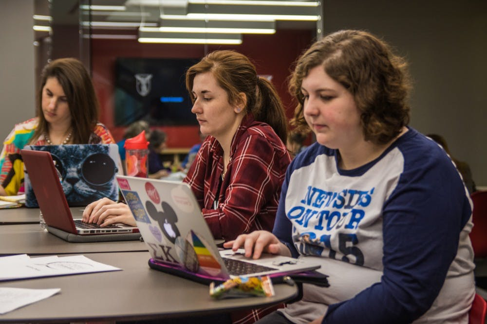 Members of Cardinal Communications, a Ball State student-run public relations agency, brainstorm ideas for local nonprofits during their first CreatAthon in the Holden Strategic Communications Center on March 24. The 24-hour event allowed students to use their professional skills to create new advertising and marketing solutions for the Animal Rescue Fund, Little Red Door and YWCA. Reagan Allen // DN
