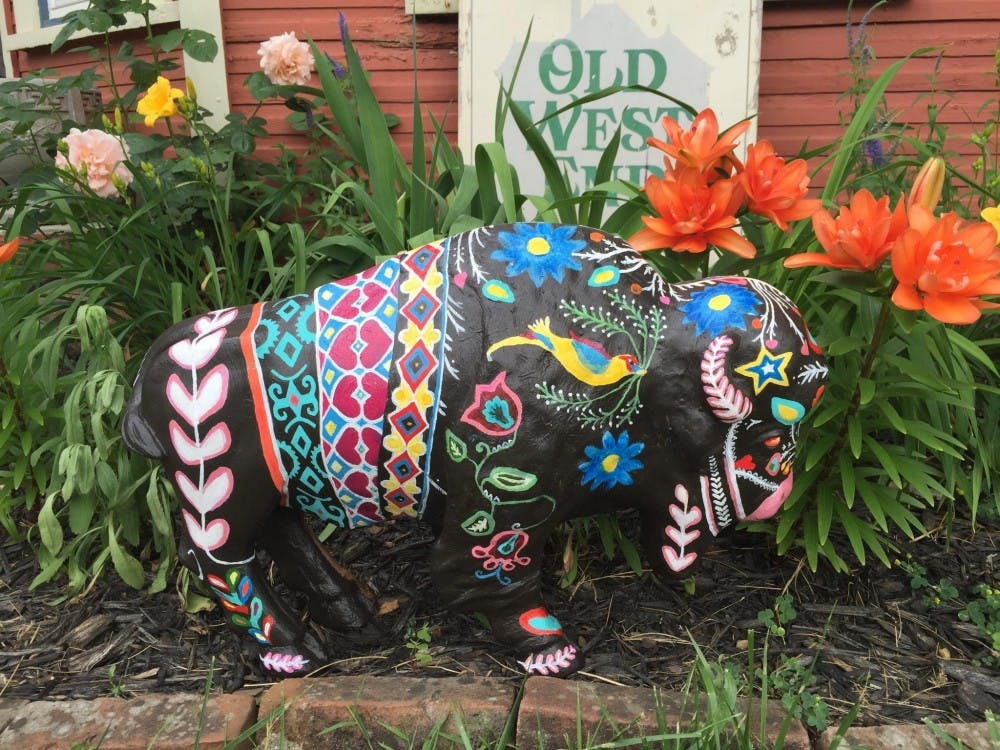 "<p>Denise King has painted her&nbsp;baby ""practice"" bison and will paint&nbsp;a&nbsp;5-foot tall fiberglass bison on location so the community can watch the bison come to life. <em>PHOTO COURTESY OF MUNCIECALENDAR.COM</em></p>"