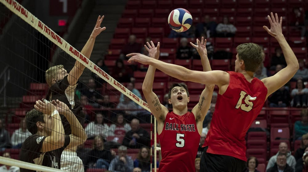 <p>Junior setter Quinn Isaacson sets a ball for a teammate March 2, 2019, in a match against Quincy in John E. Worthen Arena. The Cardinals won the match in a 3-0 sweep. <strong>Ball State Athletics, Photo Provided</strong></p>