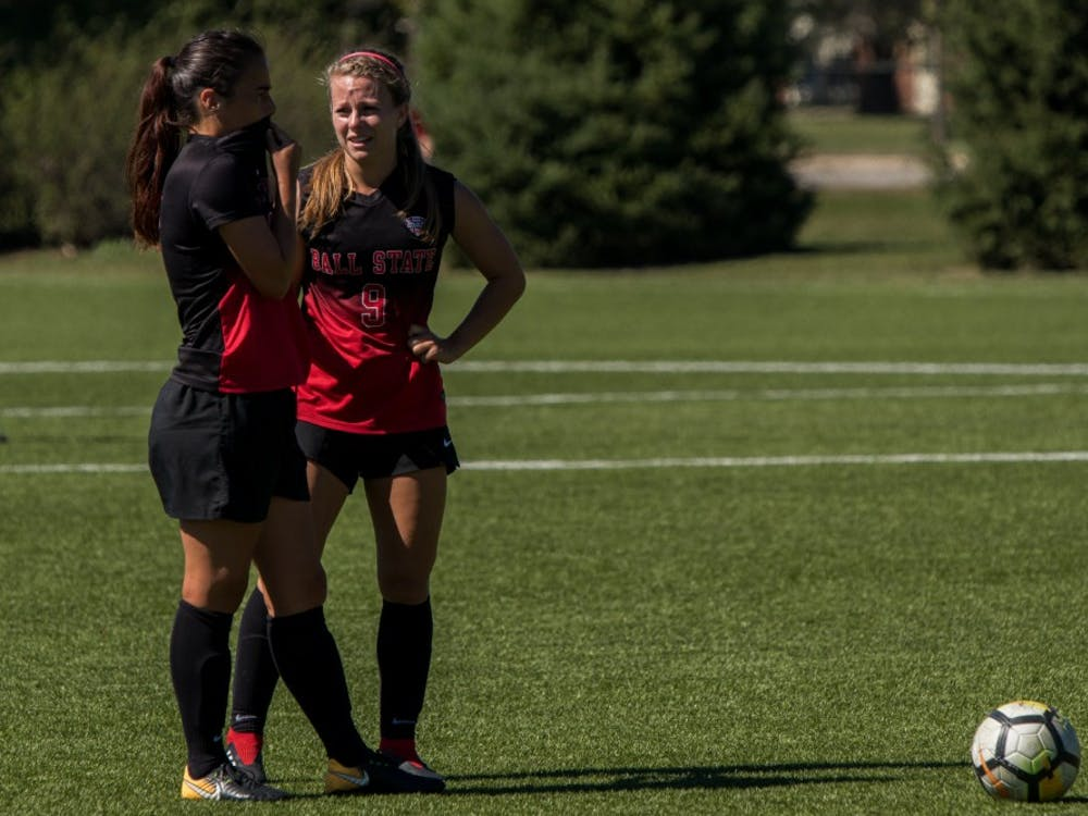 Seniors Paula Guerrero and Allison Abbe strategize before making the next play after Bowling Green received a yellow card Sept. 23, 2018, at Briner Sports Complex. Yellow cards are given to players who are cautioned on potentially dangerous plays and are out of the game if they receive two cautions. Eric Pritchett,DN