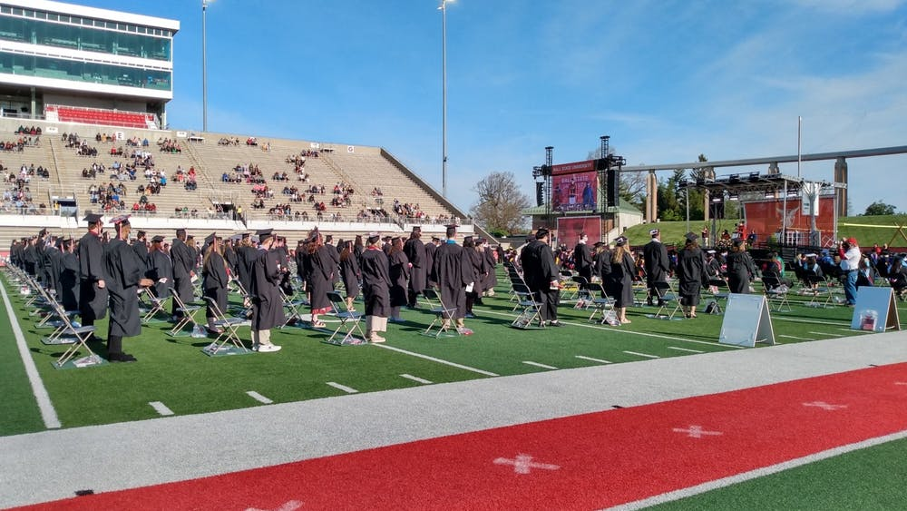 Ball State graduates from the classes of 2020 gather on the Scheumann Stadium turf May 15, 2021. Due to COVID-19, the university delayed commencement for a year, but invited graduates back to campus for a ceremony in spring 2021. Maya Wilkins, DN File