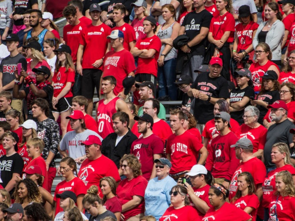 Audience members of all ages cheer on the Ball State Cardinals during the home openergame against Eastern Kentucky on Sept. 17 in Scheumann Stadium for Family Weekend. Ball State won 41-14. Grace Ramey // DN File