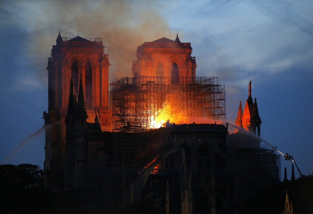 Smoke and flames rise from the Notre Dame Cathedral April 15, 2019, in Paris after a fire broke out Monday afternoon and quickly spread across the building, collapsing the spire. The cause is yet unknown but officials said it was possibly linked to ongoing renovation work.(AP Photo/Michel Euler)