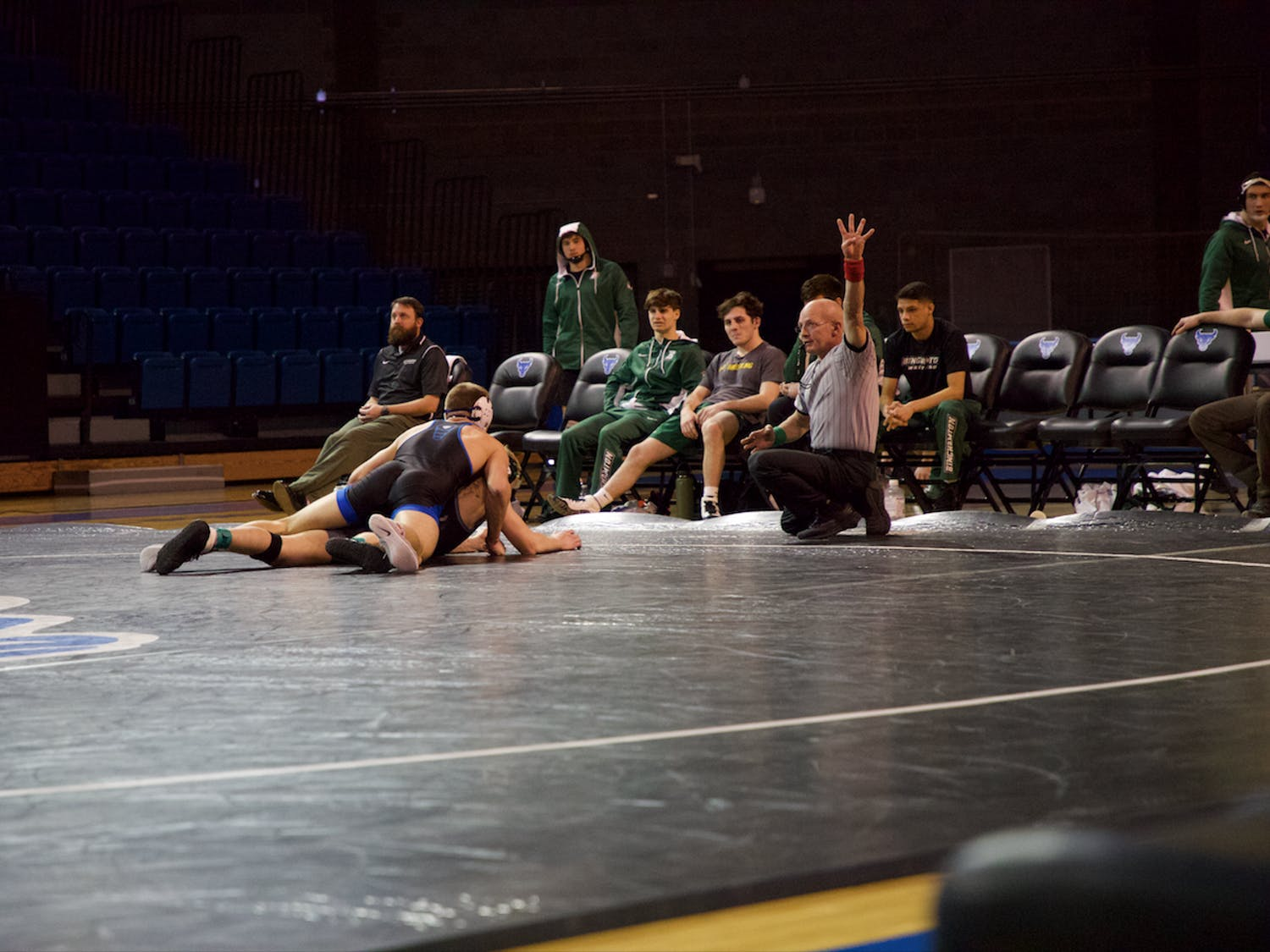 UB senior wrestler Troy Keller grapples Binghamton University junior Dylan Wood in February.
