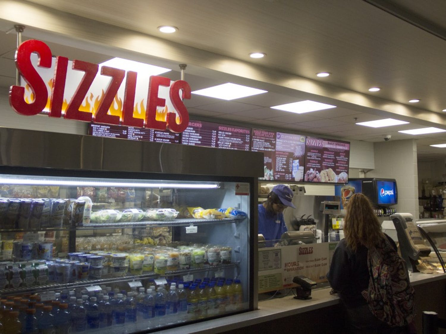 Students wait in line for food at the Ellicott Food Court. A number of students are concerned with Campus Dining & Shops' change to weekend meal credit acceptance at places like Hubie's and Sizzles.