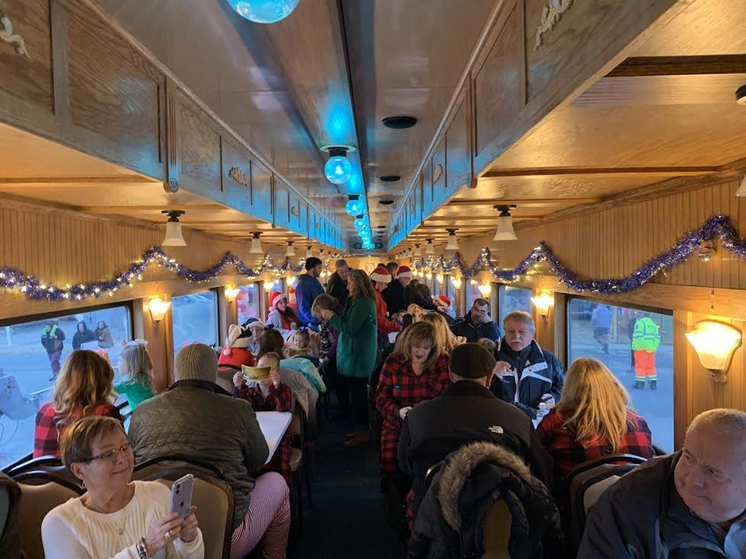 Passengers take their seats and eagerly await the train's departure to the North Pole.