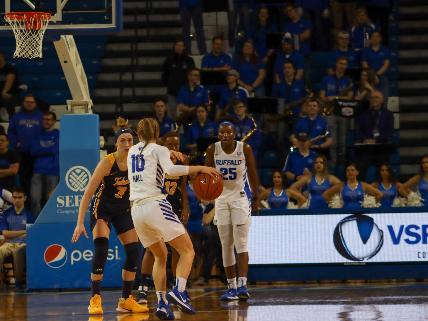 Junior guard Hanna Hall dribbles the ball at Saturday's game against Toledo.