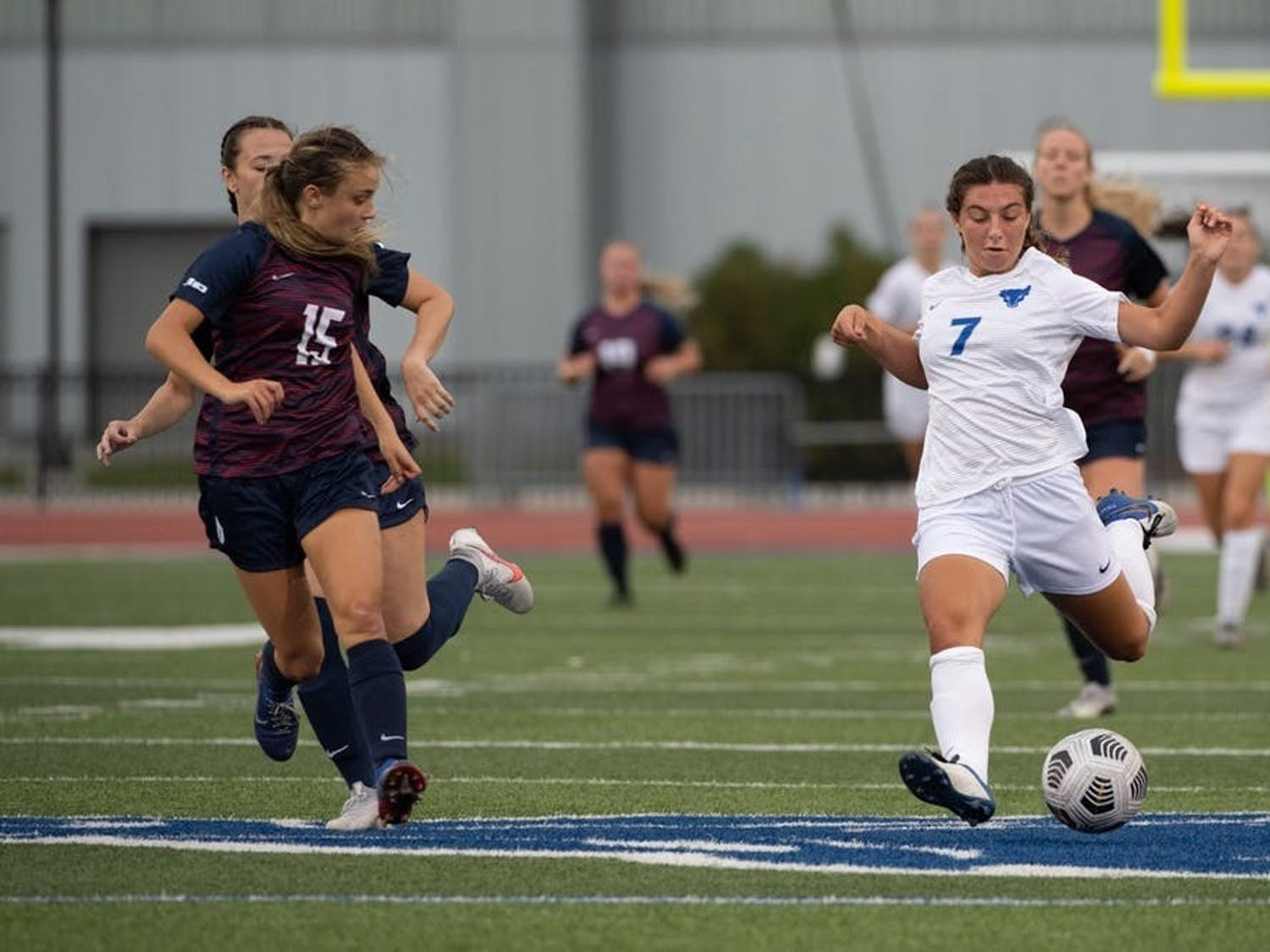 Riley Bowers (7) prepares for a kick during a women's soccer game last season.