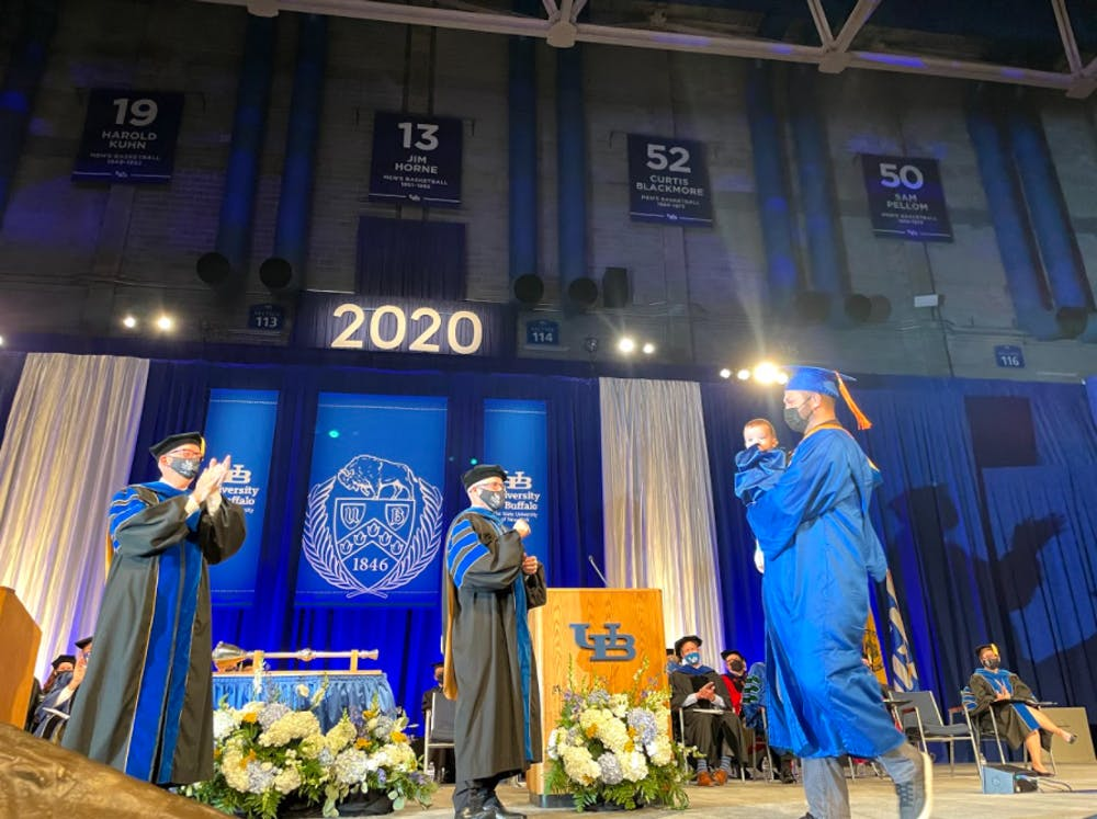 David Hooper walked the stage with his nine-month-old on Friday.