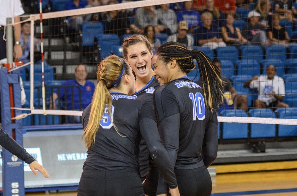 <p>(From left to right) Senior outside hitter Marissa Prinzbach, freshman middle blocker Megan Wernette and senior middle blocker Akeila Lain celebrate in a&nbsp;game in Alumni Arena earlier this season. The Bulls' season ended Thursday night with a 3-1 loss to Ball State in the MAC Tournament.&nbsp;</p>