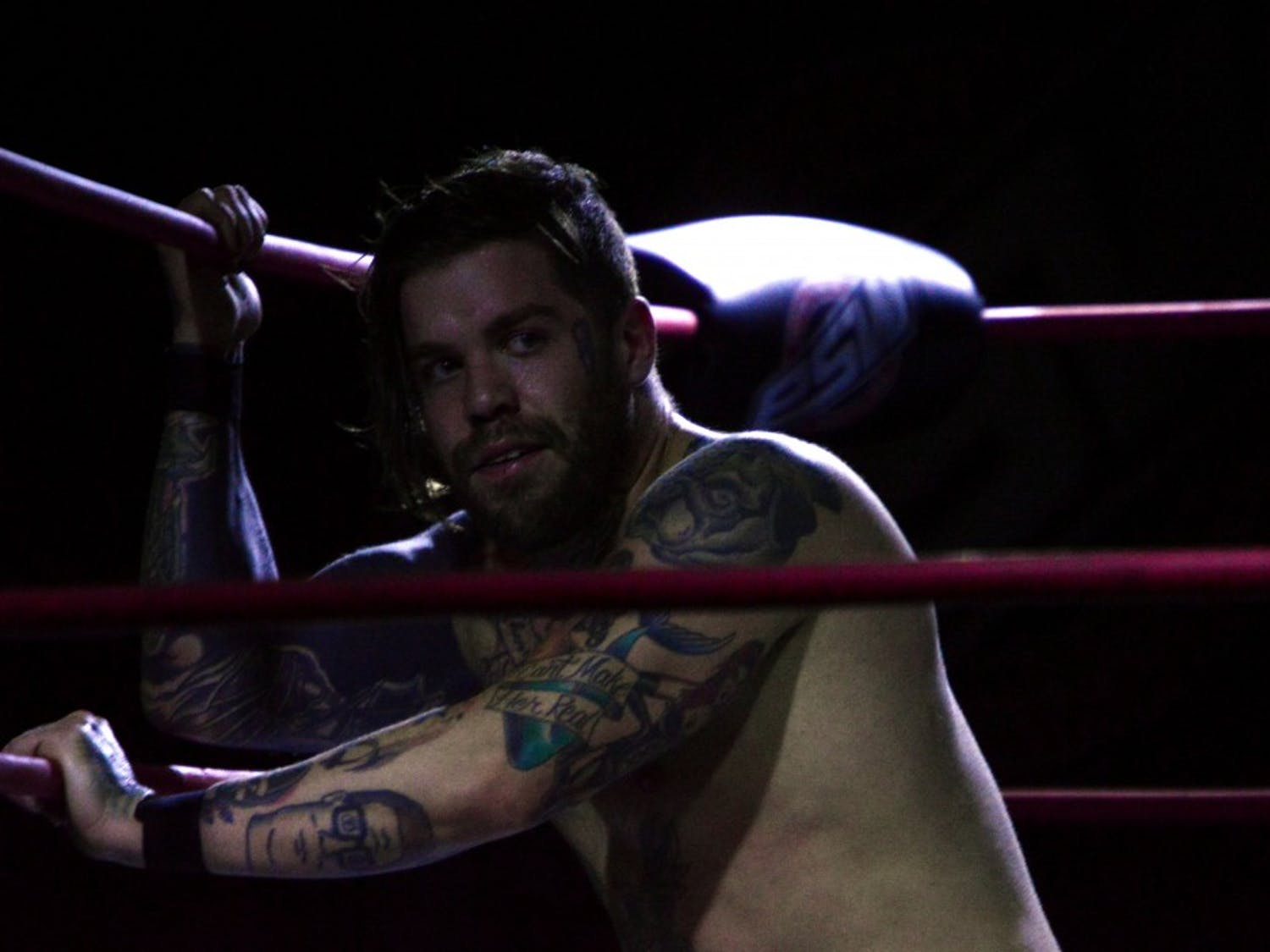 Kevin Lockwood pulls himself from the mat using the ring ropes. Lockwood is a naturally talented wrestler who wrestles for Smash Wrestling in Canada as Kevin Blackwood.