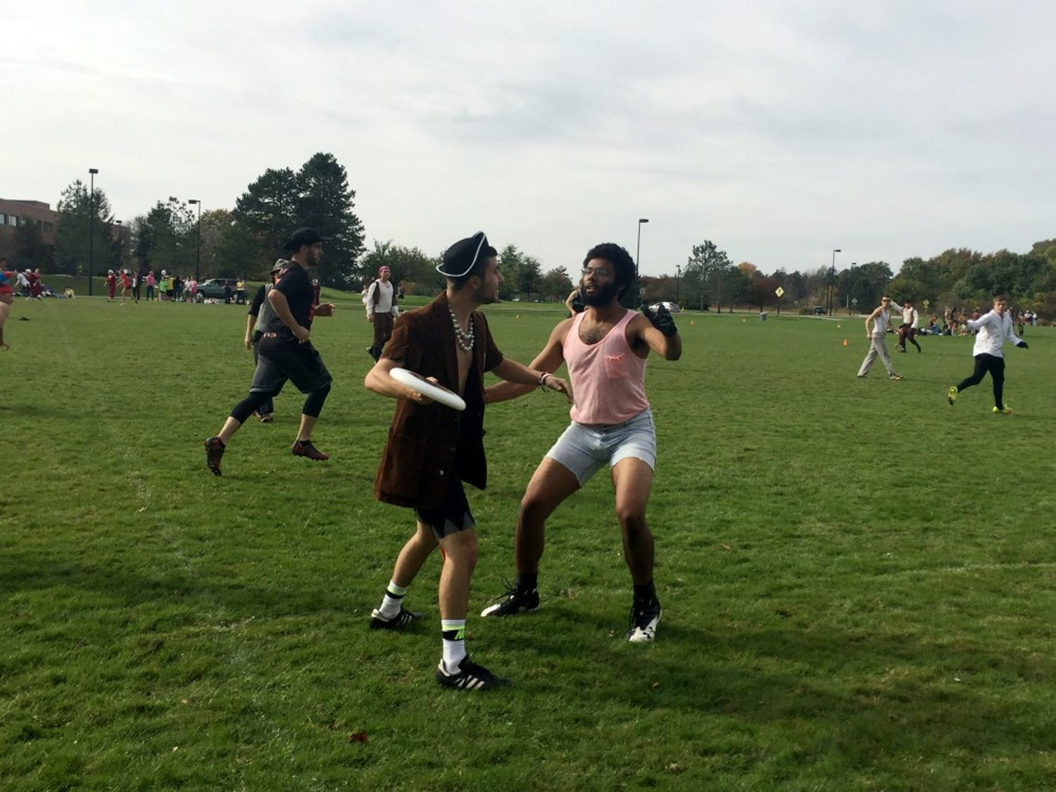 A hustler tries blocking a pirate during an ultimate frisbee game. Many dream match-ups happened this past weekend at the Danse Macabre frisbee tournament.