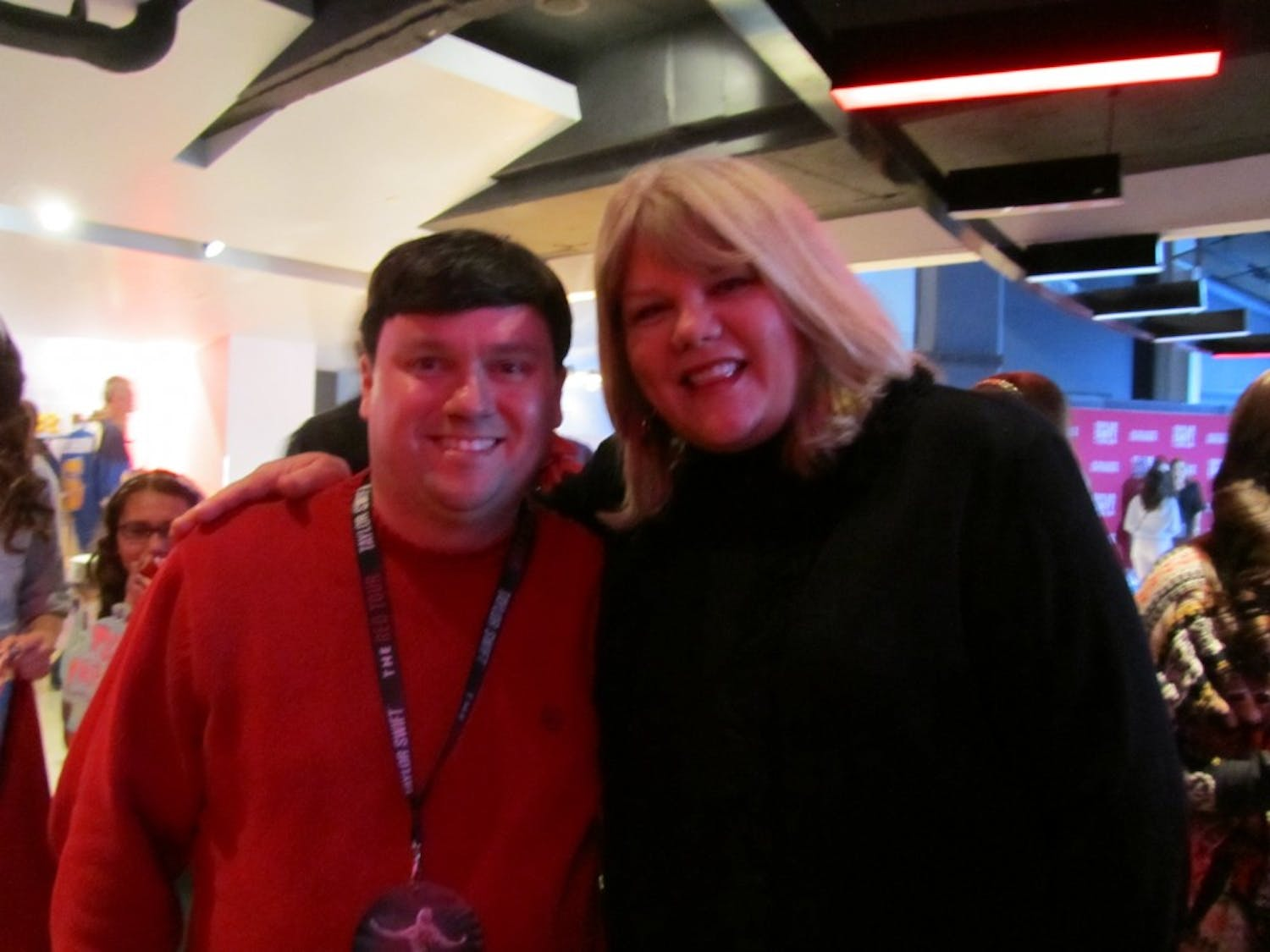 """Political science professor Shawn Donahue stands with Taylor Swift's mom during the St. Louis stop on the """"Red Tour."""""""