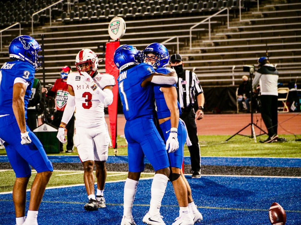<p>Senior wide receivers Antonio Nunn (1) and Jovany Ruiz (41) celebrate after a UB touchdown.</p>