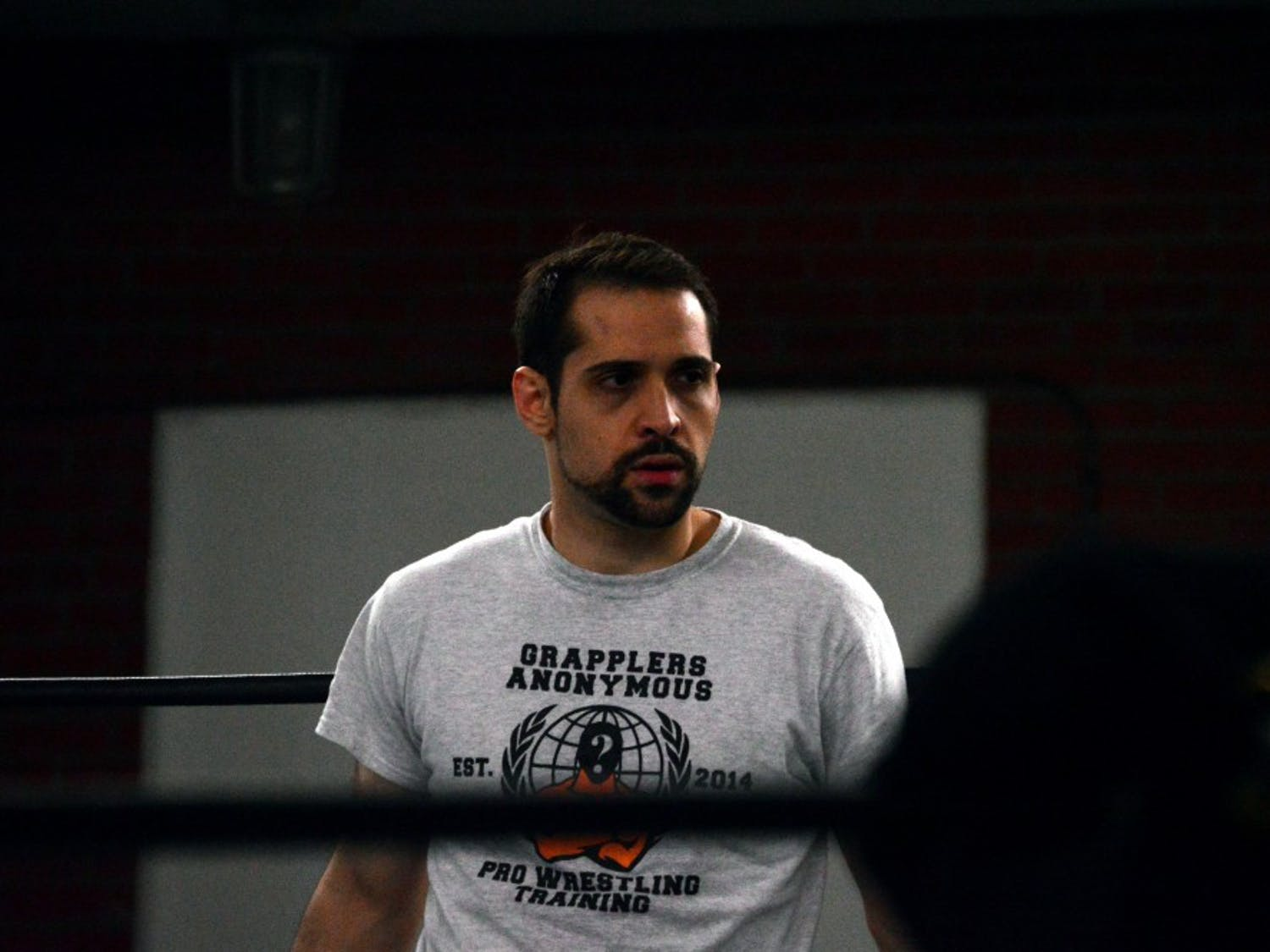 Brandon Thurston observes training at a Grapplers training session. Thurston is the head trainer at the gym, where he teaches a new generation of Western New York wrestlers.
