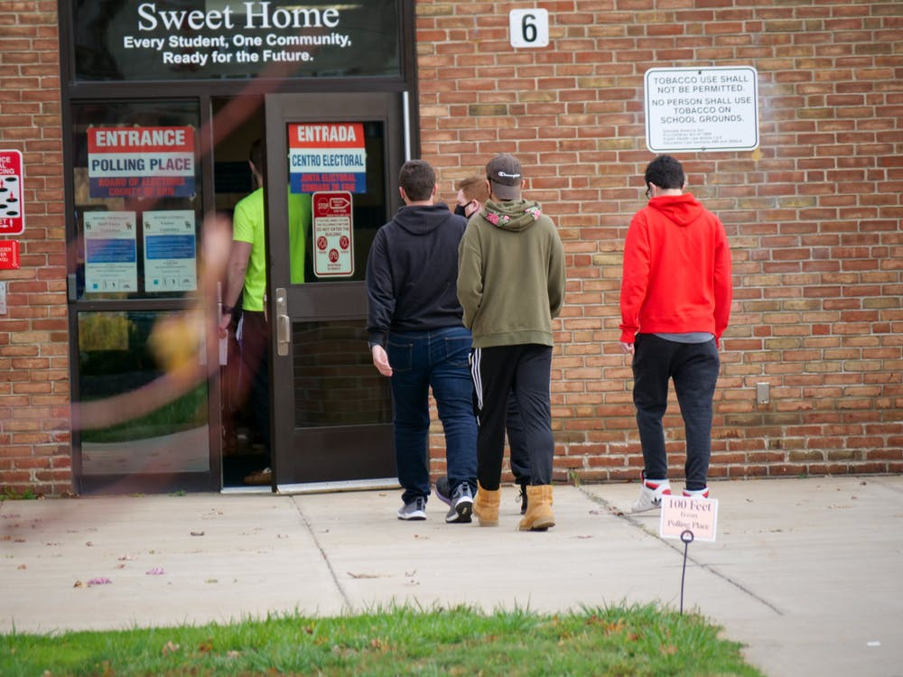 <p>Young voters walking inside Sweet Home High School to cast their ballot for the 2020 election&nbsp;</p>