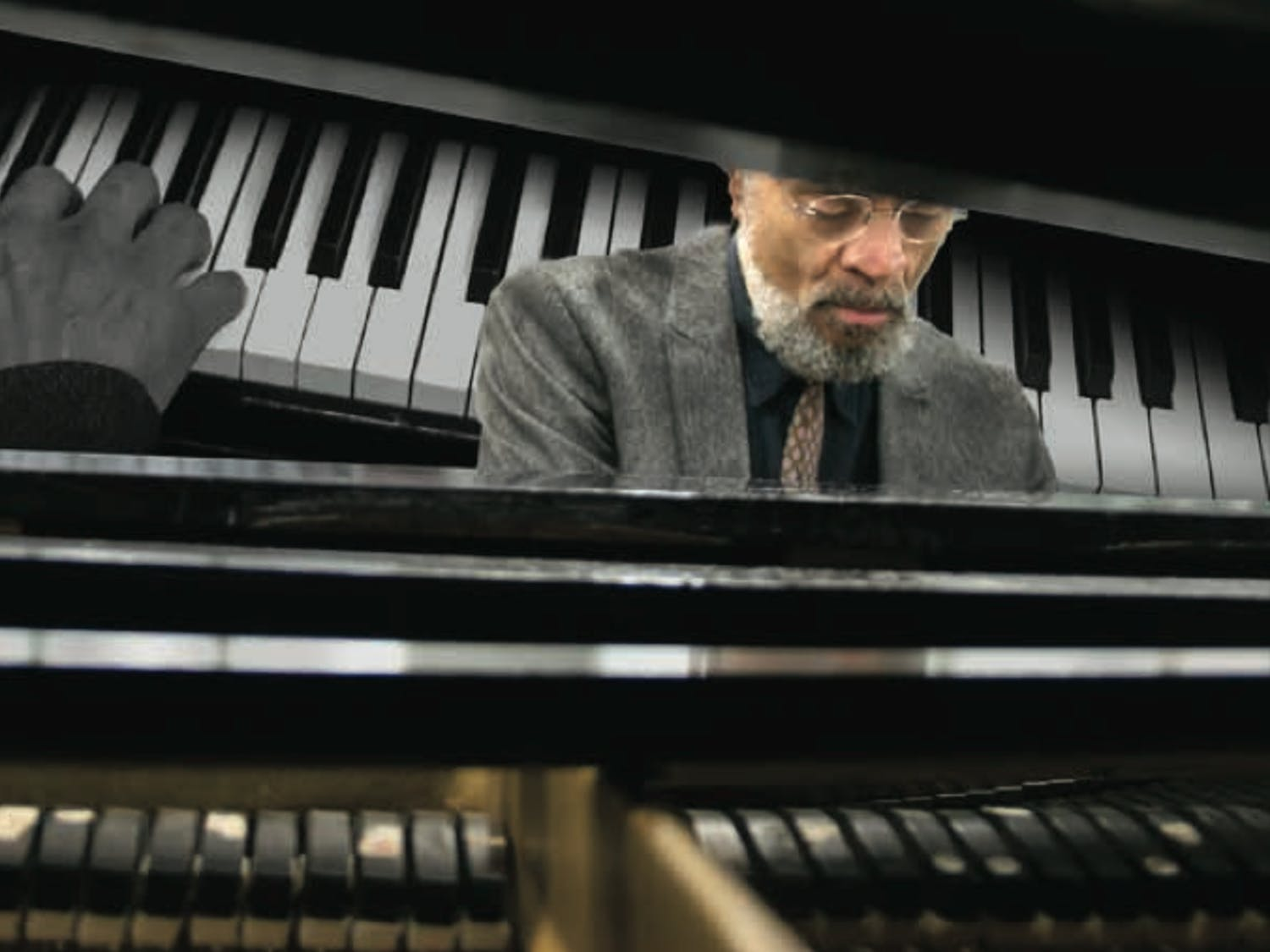 UB instructorGeorge Caldwell sits behind the piano.Grammy Award-winning jazz pianist inspires his students by imparting lessons from his past.
