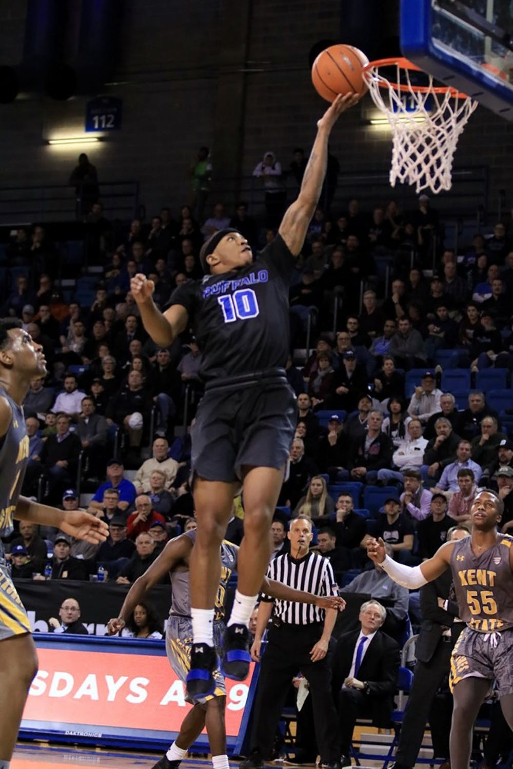 <p>Senior guard Wes Clark going for the layup. The men's basketball team won its first MAC season title Tuesday night.</p>