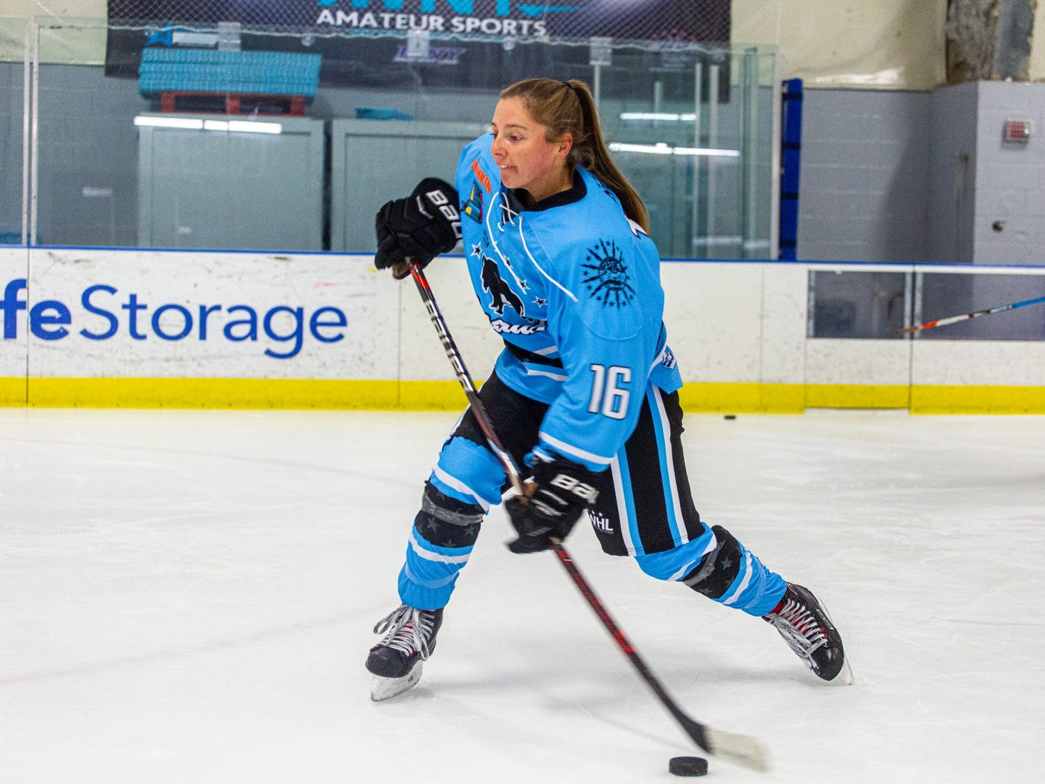 Former UB women's club hockey star and current Buffalo Beauts forward Maddie Norton winds up for a slapshot.